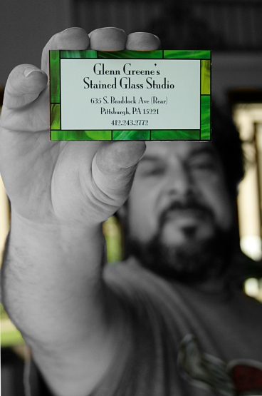Photo of Glenn Greene holding business card